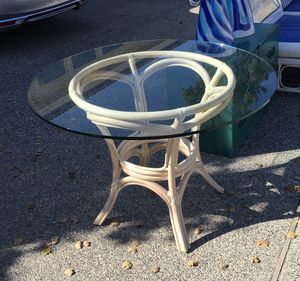 Glass top bamboo table for sale with four chairs and cushions. for Sale in Manson, WA