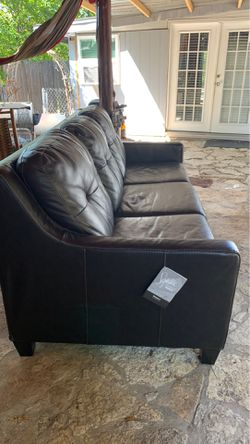 Almost New REAL leather sleeper couch from Ashley Furniture for Sale in Austin,  TX