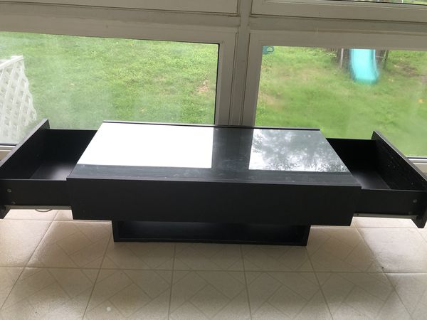 Coffee table with side drawers
