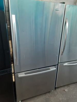 $399 Whirlpool stainless steel bottom freezer fridge measures 33 wide includes delivering the San Fernando Valley a warranty and installation for Sale in Los Angeles, CA