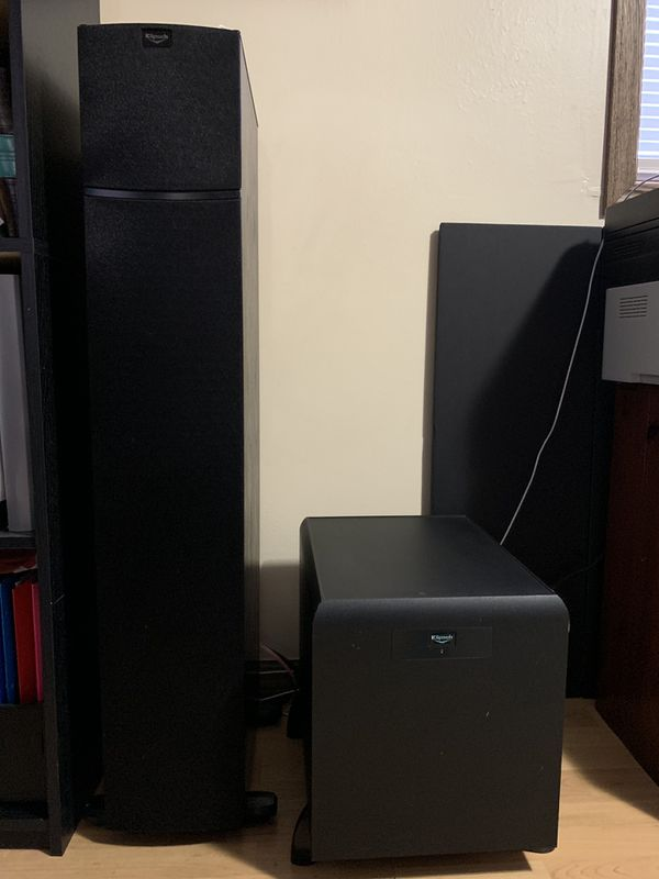 Denon receiver with 7 Klipsch speakers and 1 subwoofer