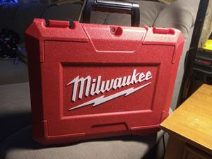 Milwauke hard case for impac and charger and 2 battery s for Sale in Fontana, CA