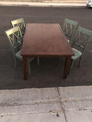 Cute wood dining table with 4 chairs for Sale in Las Vegas, NV