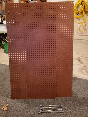 Like new, 2 pieces of pegboard. 2x4x 5.2mm. Also includes 5 10 inch pegs. Retais for more than $30 for Sale in Manassas, VA