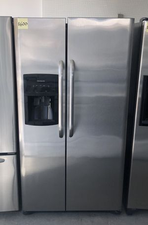 Comes with free 6 Months Warranty-like new stainless steel side by side refrigerator Frigidaire for Sale in Detroit, MI