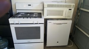 Gas stove, Dishwasher, above range microwave, and glass TV stand for Sale in Las Vegas, NV