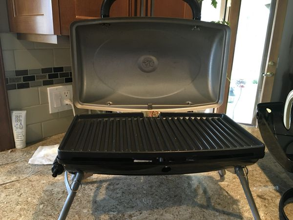 George Foreman portable gas grill. Great for camping or just on your patio. Comes with carrying case.