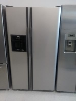Kenmore side by side stainless steel refrigerator used good condition 90days warranty for Sale in Mount Rainier, MD
