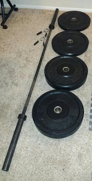 7 foot elite competition x training 2.0 olympic barbell 20kg. Pair of 45lb and 25lb Olympic rubber bumper plates and 2 weight lock clips. for Sale in Deerfield Beach, FL