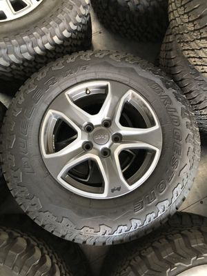 """New Jeep Wrangler Unlimited Sahara 17"""" WHEELS and TIRES for Sale in Bakersfield, CA"""