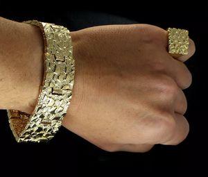 "14k gold plated Premium Plating over Alloy metal Bracelet Measurements: 8"" Length 24mm Width Ring Measurements 20mm for Sale in Los Angeles, CA"