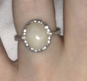 Size 5 opal ring surrounded by small diamonds set in sterling silver for Sale in Miami, FL