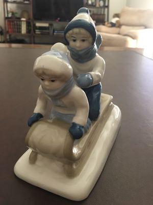 Kids sledding figurine. Lladro replica for Sale in Redlands, CA