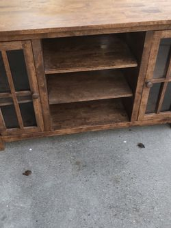 Home Goods Item: Solid Wood glass Doors / Multiple Storage 48 Inches Wide / 18 Inches Deep / 30 Inches High for Sale in Fresno,  CA