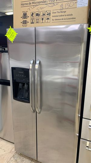 Refrigerator side by side stainless steel 90 day warranty free delivery for Sale in West Palm Beach, FL