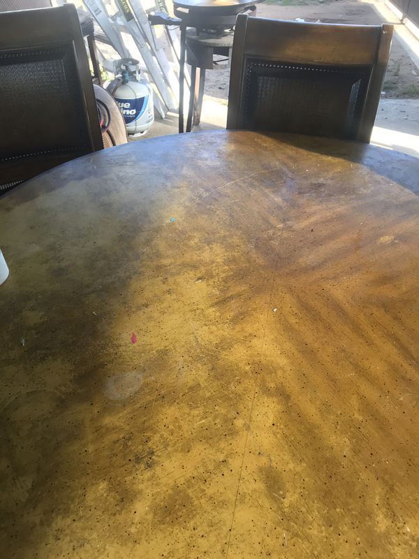Round Rustic Brown Table Top with chairs