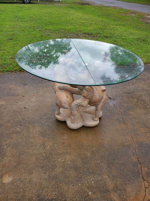Elephant glass top dining room table for Sale in Pensacola, FL