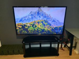 60 inch LG TV with stand and table for Sale in Miami, FL