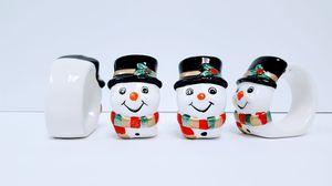 FOUR SNOWMEN NAPKIN RINGS VINTAGE IN ORIGINAL PACKAGING for Sale in Orlando, FL