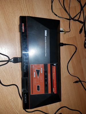 Sega master system 2 games 2 controllers for Sale in Cardington, OH