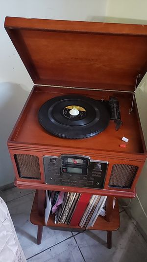 Crosley records player record records into a CD (stand included) for Sale in Santa Ana, CA