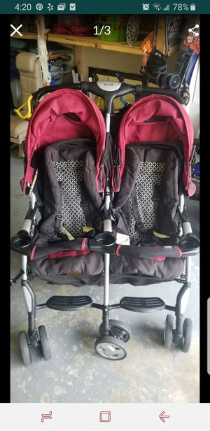 Double stroller combi red and black for Sale in Boynton Beach, FL