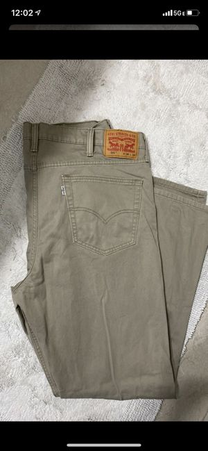 USED LEVIS IN GREAT CONDITION...SIZE 38/34 ...$15 dlls ....AUTHENTICS FROM MACYS ...FIRM/NO DELIVERY for Sale in Colton, CA