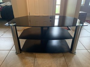 Black and silver TV stand for Sale in Poinciana, FL