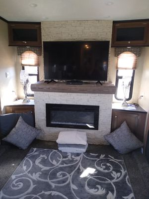 2020 40ft fifth wheel three slides two airs rock fireplace washer and dryer elec. awning large fridge large stove lots of extras asking 43,000 for Sale in Show Low, AZ