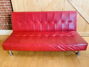 Perfect condition red leather couch/fold out futon. for Sale in St. Louis, MO
