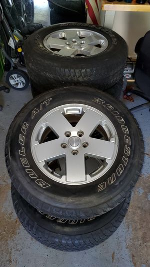 Jeep Wrangler JK 18 inch wheels and tires for Sale in Tampa, FL