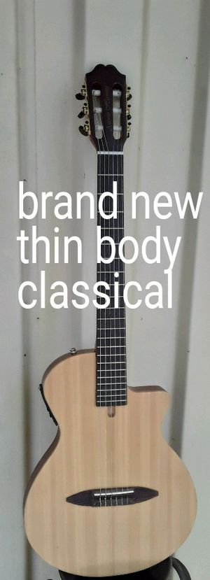 Brand new Chet Atkins style thin body classical nylon string guitar for Sale in Mt. Juliet, TN