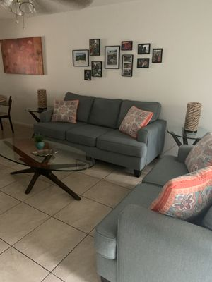 Living room with tables 450 for Sale in Orlando, FL
