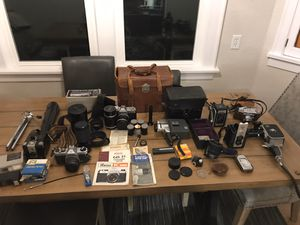 Vintage Lot of 35mm Cameras, Lenses, Accessories and 8mm cameras for Sale in Tacoma, WA