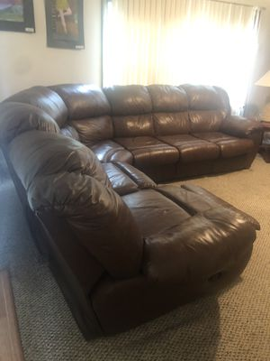 Brown like new sectional very comfy with pull out bed inside couch for Sale in Buffalo, NY