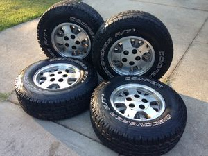 chevy silverado factory 15 inch rims with new tires for Sale in Anderson, SC