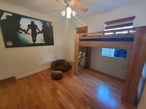 Rooms to Go Kids bunk bed with matress plus football wall mural, plus football chair, plus football foot rest. $100 for Sale in Tampa, FL