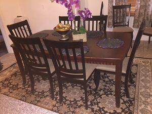 Kitchen table with one extension and 8 chairs for Sale in St. Louis, MO