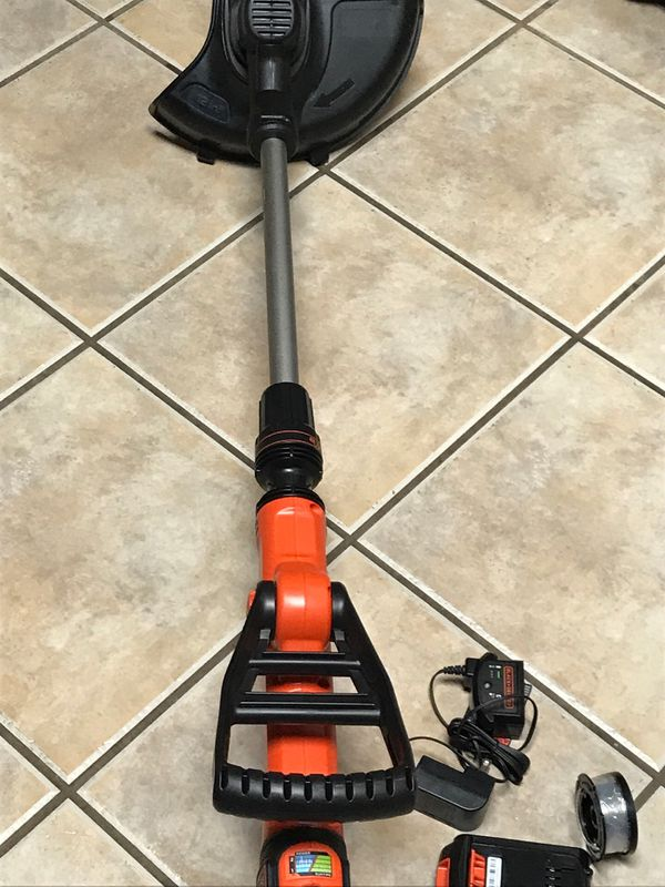Like new Black and Decker 20V weed trimmer with battery and charger with new spool of cord easy feed