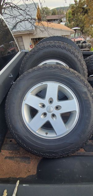 4 wheels for jeep wrangler they have decent tread on the tires. for Sale in Payson, AZ