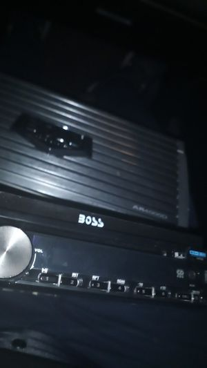 Boss dvd screen car stereo newer edition with pairing 4000 watt amplifier for Sale in Phoenix, AZ