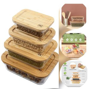 Bovado Glasswear 4 glass storage organization containers w/ bamboo cutting board lids for Sale in Las Vegas, NV