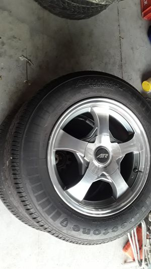 4 15 inch American Racing rims with tires three tires are good one needs replaced for Sale in Virginia Beach, VA