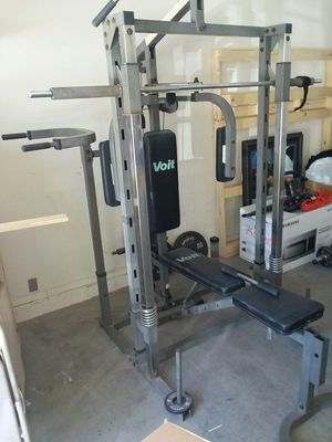 220lbs of Olympic weights Home gym set Decent shape, everything works, Lat bar 2 dumbbell bars 2 curl bars ... se abla español for Sale in Buckeye, AZ