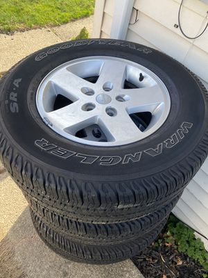 4 Jeep rims with good year tires 255/75/17 for Sale in Cleveland, OH