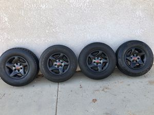 """4 stock 16"""" Toyota wheels OEM rims flat black TRD styled with almost new 245/70R16 tires balanced ready to go $400 in Ontario 91762 for Sale in Ontario, CA"""