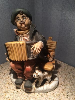 Figurine- Accordion Player with Dog and Squirrel for Sale in Holmdel, NJ