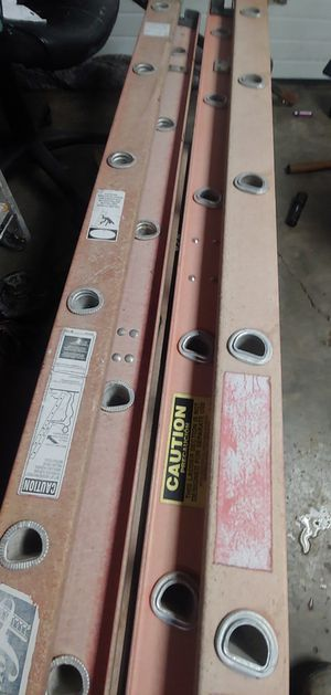 Ladders two 24' and one 16' fiberglass/ 24' and 16' aluminum for Sale in Sugar Creek, MO