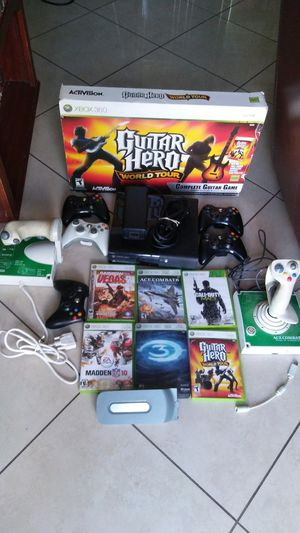 Used 360 Xbox with 6 games, 5 , guitar, and 2 extra. 2 contoler for flying the airplane game. A hardrive included.Everything works. for Sale in Ontario, CA