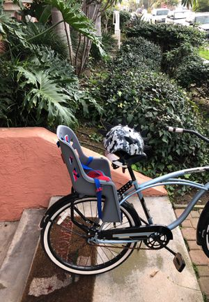 Bell Bike seat for kids, includes a small child's helmet for Sale in Imperial Beach, CA
